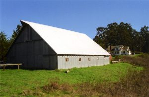 Hagmaier Ranch. Main barn with house in the background. Color image.