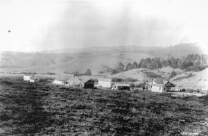 Hagmaier Ranch, ca. 1931-1941. (Source: Daniel Hagmaier. Credit: Point Reyes National Seashore Museum, HPRC 58080.) Hagmaier Ranch: Landscape view looking NE with ranch buildings and house. Wide and long view. Rolling grass covered hills in distance.